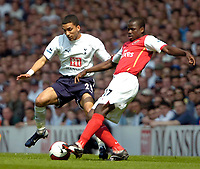 Photo: Ed Godden/Sportsbeat Images.<br /> Tottenham Hotspur v Arsenal. The Barclays Premiership. 21/04/2007. Spurs' Aaron Lennon (L), is tackled by Emmanuel Eboue.