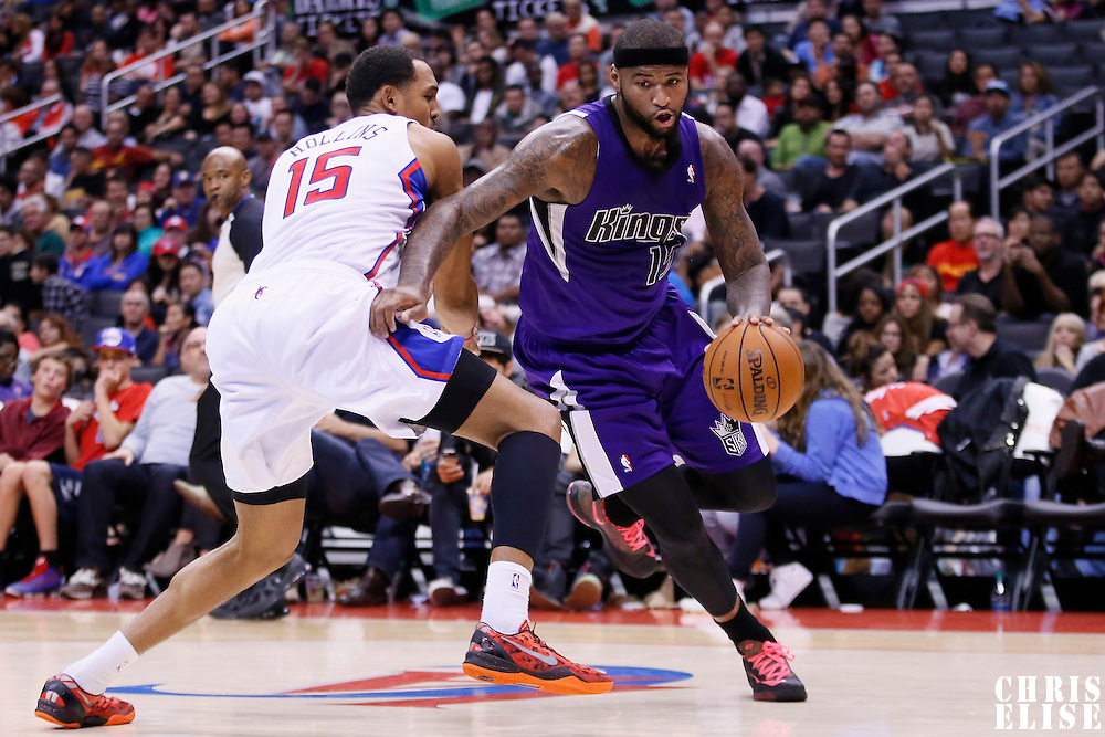 25 October 2013: Sacramento Kings center DeMarcus Cousins (15) drives past Los Angeles Clippers center Ryan Hollins (15) during the Sacramento Kings 110-100 victory over the Los Angeles Clippers at the Staples Center, Los Angeles, California, USA.