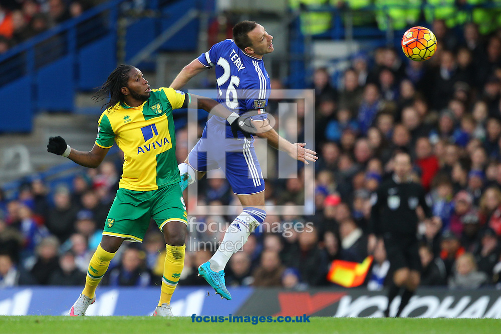 Dieumerci Mbokani of Norwich and John Terry of Chelsea in action during the Barclays Premier League match at Stamford Bridge, London<br /> Picture by Paul Chesterton/Focus Images Ltd +44 7904 640267<br /> 21/11/2015
