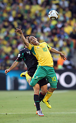 11.06.2010, Soccer City Stadium, Johannesburg, RSA, FIFA WM 2010, Südafrika vs Mexico im Bild Steven Pienaar of South Africa in action with Rafael Marquez of Mexico, EXPA Pictures © 2010, PhotoCredit: EXPA/ IPS/ Mark Atkins / SPORTIDA PHOTO AGENCY