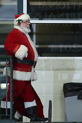 12 December 2015:  Santa Claus strolls the Shirk Center handing out candy canes during an NCAA women's basketball game between the Wisconsin Stevens Point Pointers and the Illinois Wesleyan Titans in Shirk Center, Bloomington IL
