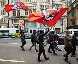 © Licensed to London News Pictures. 01/04/2017. LONDON, UK.  EDL and Britain First protest march through central London. The Met police imposed conditions on the protest and a counter protest in the expectation of serious disorder.  In this picture: Anti-fascist protesters on Whitehall.   Photo credit: Cliff Hide/LNP