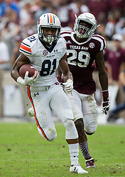 Auburn wide receiver Darius Slayton (81) out runs Texas A&M defensive back Debione Renfro (29) for a touchdown after a long catch during the second quarter of an NCAA college football game on Saturday, Nov. 4, 2017, in College Station, Texas. (AP Photo/Sam Craft)