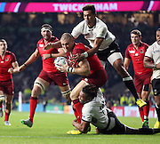England's Full Back Mike Brown getting tackled by two players yet still managing to score his second try during the Rugby World Cup Pool A match between England and Fiji at Twickenham, Richmond, United Kingdom on 18 September 2015. Photo by Matthew Redman.