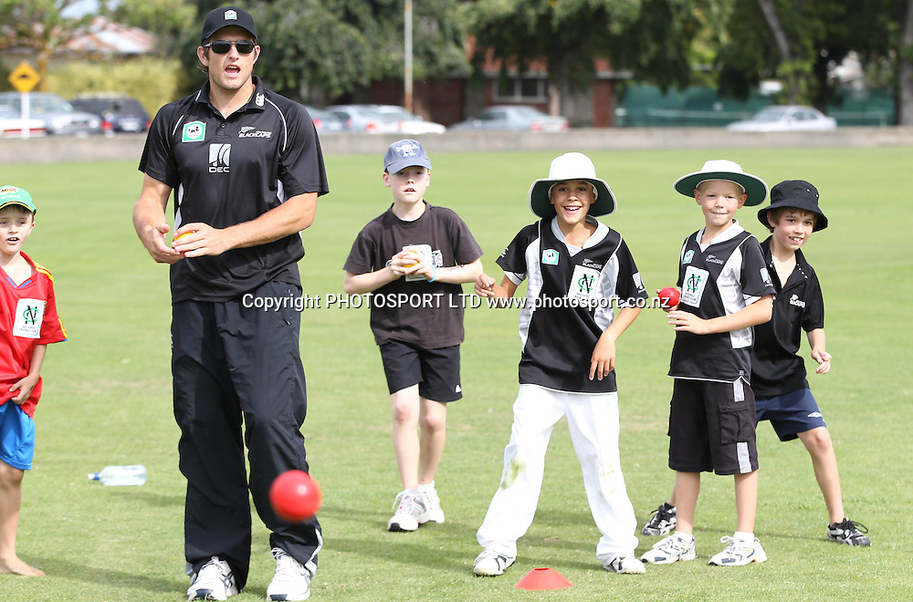 Hamish Bennett helps out at the National Bank's National Cricket Club ( NCC ) Supercamp, Nelson Park, Napier, Sunday 30 January 2011. Photo: Andrew Cornaga/photosport.co.nz
