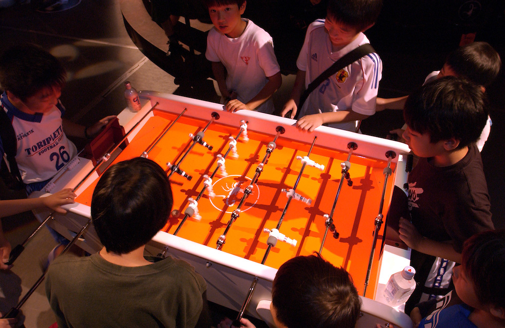 Budding Japanese soccer players compete in a game of table soccer at Harajuku, Tokyo. 23/06/02..©David Dare Parker/AsiaWorks Photography
