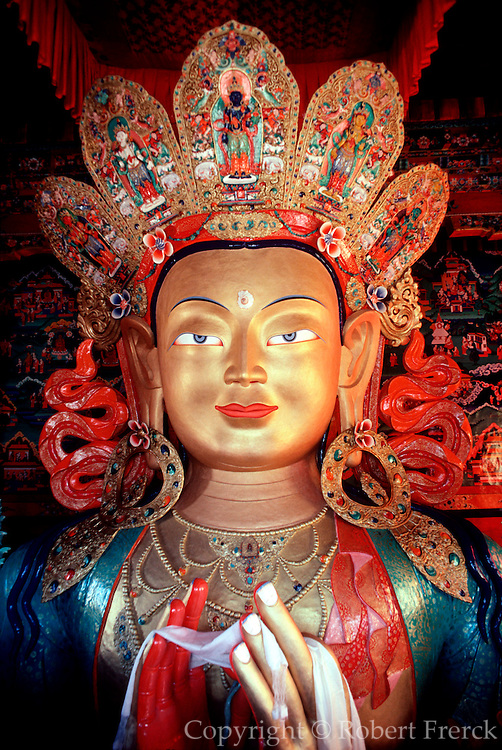 INDIA, RELIGION, BUDDHISM Ladakh; Tikse Buddhist Monastery in the Himalaya Mountains, contains a 45' tall  golden statue of Buddha