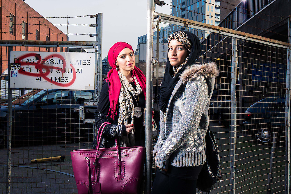 Hiba Alhejazi  (Red Hajib) aged 23  who has an MA in Middle Eastern Politics &amp; her sister Saryah (leopard print Hijib)  photographed in Brick Lane, London on Monday 20th January 2014.<br /> Muslim fashion easters have come into the headlines after a You Tube sensation called the Mipsterz.<br /> <br /> photo by Ki Price