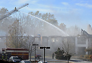 Firefighters continue to pour water on hot spots Friday November 17, 2017 after a 5-alarm fire at Barclay Friends Nursing Home in West Chester, Pennsylvania. The fire has displaced at least 200 residents of the facility. (WILLIAM THOMAS CAIN/ For The Philadelphia Inquirer)