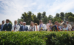 © Licensed to London News Pictures. 04/07/2018. Henley-on-Thames, UK. People in rowing club colour jackets enjoy day one of the Henley Royal Regatta, set on the River Thames by the town of Henley-on-Thames in England. Established in 1839, the five day international rowing event, raced over a course of 2,112 meters (1 mile 550 yards), is considered an important part of the English social season. Photo credit: Ben Cawthra/LNP
