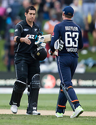 New Zealand's Ross Taylor, left, and England's Jos Buttler shake hands at the end of the fourth one day cricket international at the University of Otago Oval, Dunedin, New Zealand, Wednesday, March 7, 2018. Credit:SNPA / Adam Binns ** NO ARCHIVING**