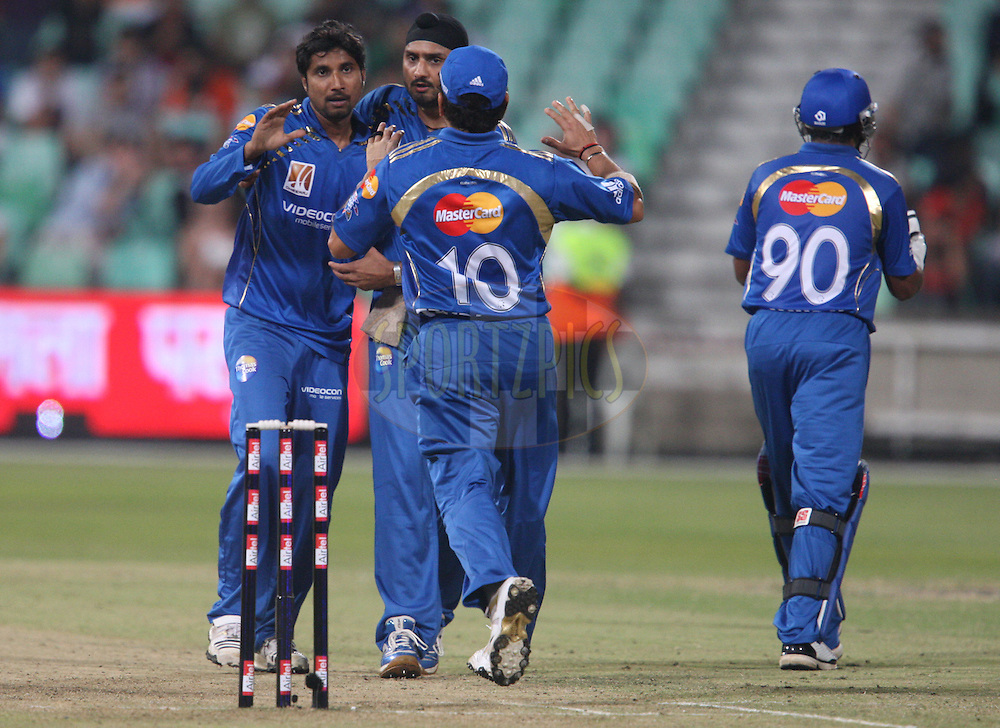 Ali Murtaza celebrates with Harbhajan Singh  and Sachin Tendulkar . during the match 7 of the Airtel CLT20 between The Mumbai Indians and The South Australian Redbacks held at Kingsmead Stadium in Durban on the 14 September 2010..Photo by: Steve Haag/SPORTZPICS/CLT20.