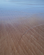 Sand patterns caused by gently flowing water on a shallow beach at Achnahaird, Assynt, Scotland.