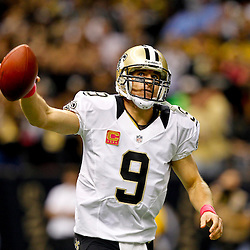 October 7, 2012; New Orleans, LA, USA; New Orleans Saints quarterback Drew Brees (9) celebrates after throwing a touchdown pass to wide receiver Devery Henderson (not pictured) to break the NFL record for consecutive games throwing a touchdown at 48 games eclipsing a record once held by Johnny Unitas during the first quarter of a game against the San Diego Chargers at the Mercedes-Benz Superdome. Mandatory Credit: Derick E. Hingle-US PRESSWIRE