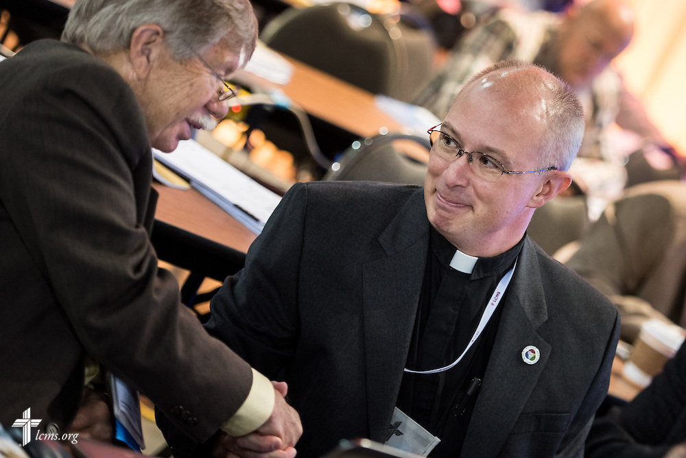 The Rev. Dr. George Gude, chairman of the LCMS Commission on Constitutional Matters, congratulates the Rev. Dr. John Wollenburg Sias, right, on being elected as secretary of the Synod at the 66th Regular Convention of The Lutheran Church—Missouri Synod on Monday, July 11, at the Wisconsin Center in Milwaukee. LCMS /Michael Schuermann