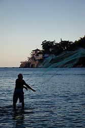 """Old Man Tossing Net 1"" - This old man tossing a fishing net was photographed in Puerto Vallarta, Mexico."