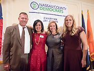 New Hyde Park, New York, USA. November 7, 2017. L-R. Running mates DOUGLAS P MAYER, SYLVIA CABANA, LAURA GILLEN, and SUE MOLLER are on stage at Nassau County Democrats Election Night Results Viewing Party at Inn at New Hyde Park. Nassau County Democratic Committee Chairman Jay Jacobs announced results: Laura Curran wins for Nassau County Supervisor, Laura Gillen wins for Town of Hempstead Supervisor, Sylvia Cabana wins for Town of Hempstead Town Clerk.