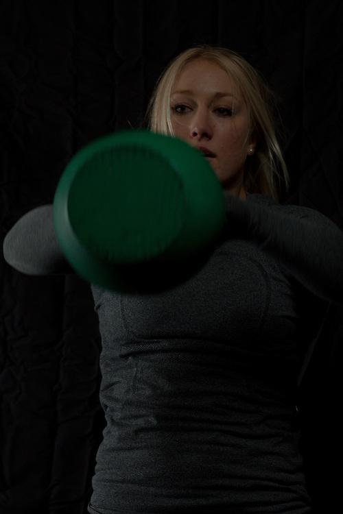 Jaelyn Wolf swings a Kettlebell