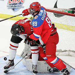 COBOURG, - Dec 19, 2015 -  Gold Metal Game - Russia vs Canada West at the 2015 World Junior A Challenge at the Cobourg Community Centre, ON. Tyson Jost #10 of Team Canada West and Ilia Karpukhin #89 of Team Russia battle for the puck in the crease during the second period. (Photo: Tim Bates / OJHL Images)