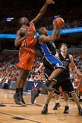Duke guard DeMarcus Nelson beats Virginia guard/forward Mamadi Diane (24) to the hoop.  The Virginia Cavaliers men's basketball team fell to the #6 Duke Blue Devils 86-70 at the University of Virginia's John Paul Jones Arena in Charlottesville, VA on March 5, 2008.