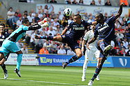West Ham's Winston Reid is denied by Swansea city keeper Michel Vorm. Barclays Premier league, Swansea city  v West Ham Utd at the Liberty Stadium in Swansea, South Wales  on Saturday 25th August 2012. pic by Andrew Orchard, Andrew Orchard sports photography,