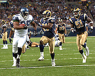 Seattle running back Mack Strong (38) rushes down field past St. Louis defenders Oshiomogho Stogwe (21) and Will Witherspoon (51) during action at the Edward Jones Dome in St. Louis, Missouri, October 15, 2006.  The Seahawks beat the Rams 30-28.<br />