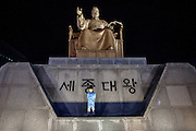 Child standing at the Statue of King Sejong located at Gwanghawmun Square. King Sejong is best remembered as the inventor of Hangeul, the Korean alphabet. During his reign, he consolidated the basis for ruling the Joseon Dynasty by incorporating Confucian philosophy of politics. Furthermore, he led the nation's great strides in agriculture, literature, science and technology.
