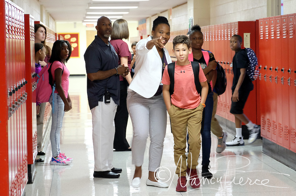 Quail Hollow Middle School staff help 6th grade students find their way to class.