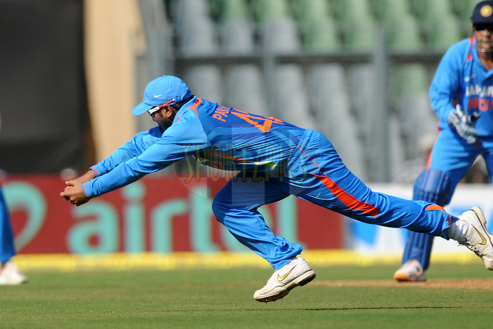 Parthiv patel of India dives to stop a ball during the 4th One Day International ( ODI ) match between India and England held at the Wankhede Stadium, Mumbai on the 23rd October 2011..Photo by Pal Pillai/BCCI/SPORTZPICS