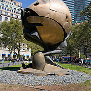 "For three decades, this sculpture stood in the plaza of the World Trade Center. Entitled ""The Sphere,"" it was conceived by artist Fritz Koenig as a symbol of world peace. It was damaged during the tragic events of September 11, 2001, but endures as an icon of hope and the indestructible spirit of the United States of America. The Sphere was placed here in Battery Park at the lower tip of Mahattan Island on March 11, 2002 as a temporary memorial to all who lost their lives in the terrorist attacks at the World Trade Center. This eternal flame was ignited on September 11, 2002 in honor of all those that were lost. Their spirit and sacrifice will never be forgotten."