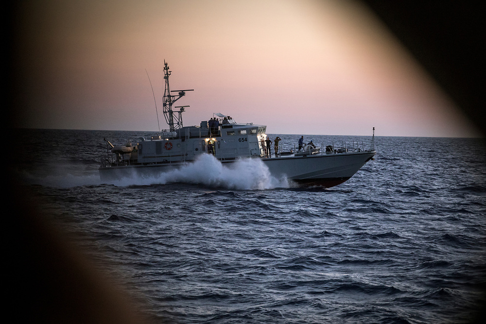June 2017, Central Mediterranean. Libyan patrol makes a very fast and intimidating approach to leave soon after. These boats have been donated by the Italian government to the authorities of Tripoli with the aim of avoiding the departure of reffugee boats. NGO Proactiva Open Arms in their 20th rescue mission in the Central Mediterranean Sea on board of Golfo Azzurro vessel (photo Edu Bayer)