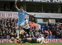 Football - 2016 / 2017 Premier League - Tottenham Hotspur vs. Stoke City<br /> <br /> Marko Arnautovic of Stoke City rides the sliding tackle of Eric Dier of Tottenham  at White Hart Lane.<br /> <br /> COLORSPORT/DANIEL BEARHAM