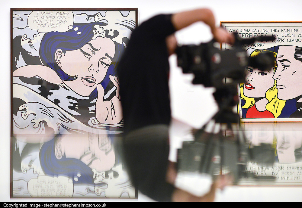 """© Licensed to London News Pictures. 18/02/2013. London, UK A camera man stand in front of """"Drowning Girl""""  1963. Press view for Tate Modern's """"Lichtenstein: A Retrospective"""". It is the first major Lichtenstein retrospective for twenty years, bringing together 125 of the artists most definitive paintings. The exhibition is open to the public from 21 February -  27 May 2013.  Photo credit : Stephen Simpson/LNP"""