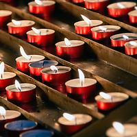 Devotional prayer candles in a Catholic church.