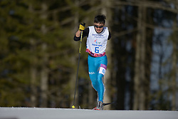 BATMUNKH Ganbold competing in the Nordic Skiing XC Long Distance at the 2014 Sochi Winter Paralympic Games, Russia