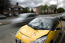 © Licensed to London News Pictures . 15/08/2015 . Manchester , UK . A vehicle which was damaged at the scene on Lightbowne Road , Moston in Manchester where a man died following a fatal road accident in the early hours of this morning (Saturday 15th August 2015) . Police report a green Rover 25 collided with a lamppost and a passenger , believed to be 21 years old , was pronounced dead at the scene . An 18 year old passenger is in hospital with life-threatening injuries and the 19 year old driver is also in hospital , in a serious but stable condition . Photo credit : Joel Goodman/LNP