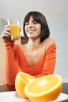 Woman holding glass with orange juice portrait