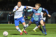 Tranmere Rovers defender Jake Caprice (14) battles for possession  with Wycombe Wanderers striker Alex Samuel (25) during the The FA Cup match between Wycombe Wanderers and Tranmere Rovers at Adams Park, High Wycombe, England on 20 November 2019.