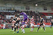 Thorsten Stuckmann of Doncaster Rovers clears the ballduring the Sky Bet League 1 match between Doncaster Rovers and Barnsley at the Keepmoat Stadium, Doncaster, England on 3 October 2015. Photo by Ian Lyall.