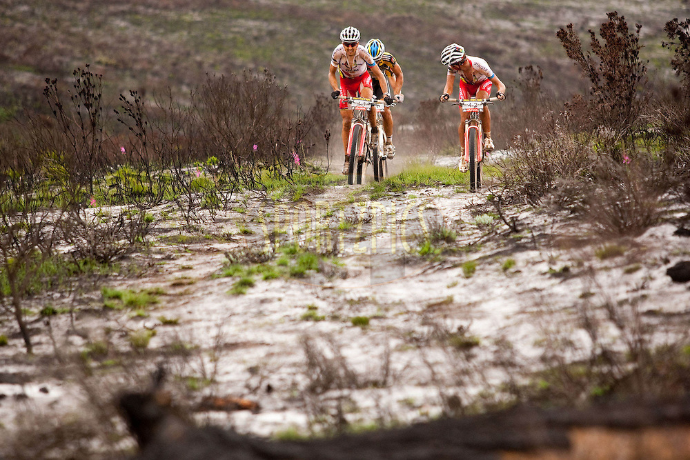 Songo-Specialized's Burry Stander and Christophe Sauser lead the Bulls during stage six of the 2010 Absa Cape Epic Mountain Bike stage race between Worcester and Oak Valley in the Western Cape, South Africa on the 26 March 2010.Photo by Sven Martin/SPORTZPICS