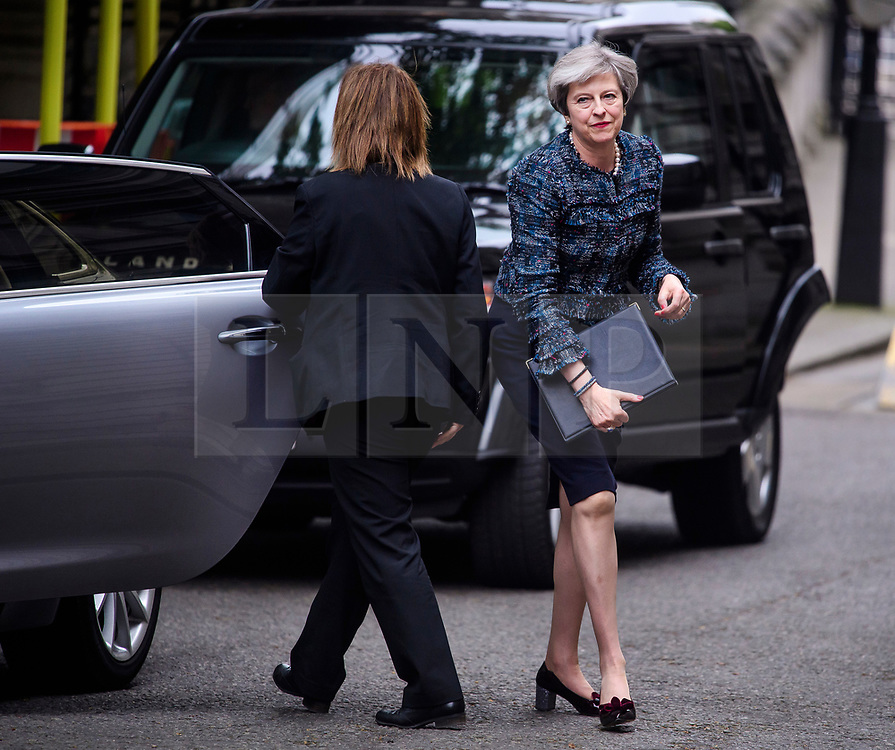 © Licensed to London News Pictures. 03/05/2017. London, UK. British prime minister THERESA MAY arrive to deliver a statement outside Downing Street in London after a meeting with The Queen to dissolve parliament ahead of an election on June 8. Photo credit: Ben Cawthra/LNP