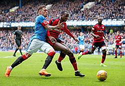 Rangers' James Tavernier (left) and Dundee's Glen Kamara battle for ball during the Ladbrokes Scottish Premiership match at the Ibrox Stadium, Glasgow.