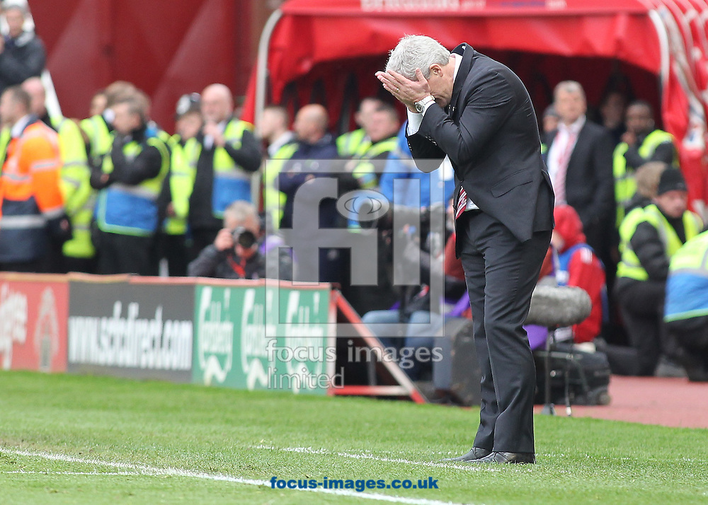 Mark Hughes, manager of Stoke City shows his frustration during the Barclays Premier League match against Tottenham Hotspur at the Britannia Stadium, Stoke-on-Trent.<br /> Picture by Michael Sedgwick/Focus Images Ltd +44 7900 363072<br /> 26/04/2014