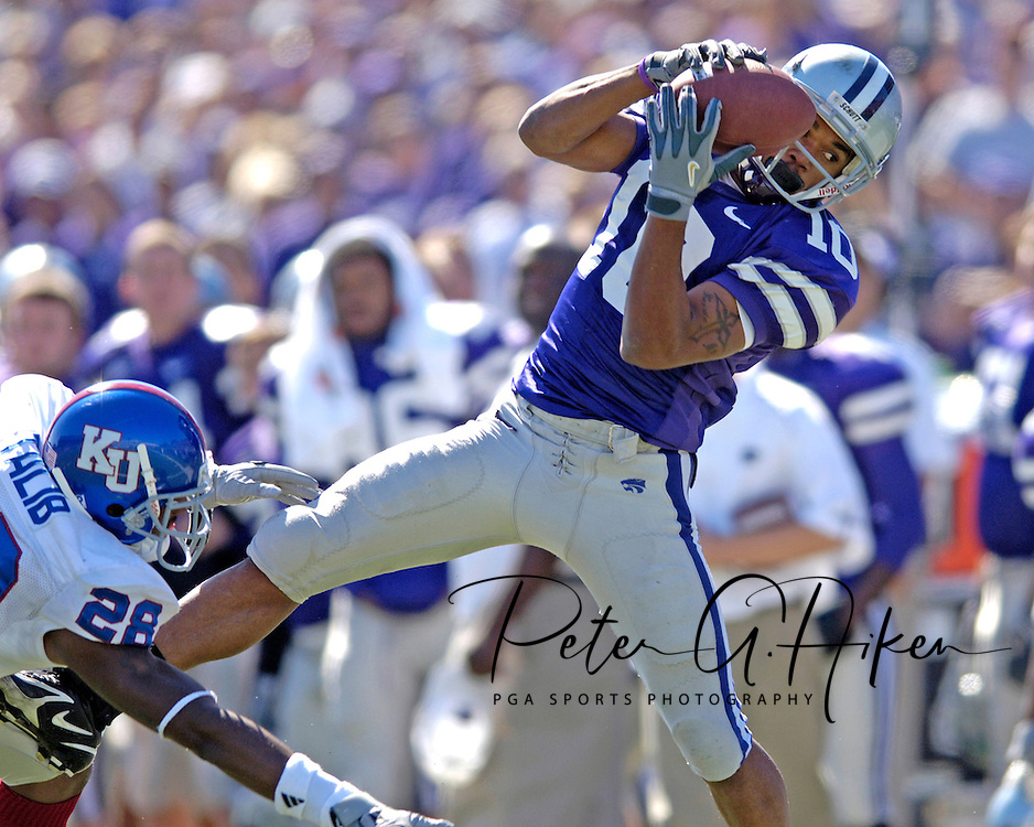 Kansas State wide receiver Jermaine Moreira (10) pulls in a 28-yard pass over Kansas strong safety Aqib Talib (28) during the second quarter.  Kansas State defeated  Kansas 12-3 at KSU Stadium in Manhattan, Kansas on October 8, 2005.
