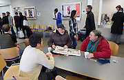 Crisis at Christmas, London, Great Britain <br /> 23rd December 2016 <br /> <br /> <br /> Kenneth Pigram from Canning Town and Lesley Trahar from Dagenham <br /> share a cuppa talk to a volunteer <br /> <br /> First day of operations at one of the Crisis centres in London.<br /> <br /> Crisis at Christmas is a lifeline for thousands of homeless people across the UK, offering support, companionship and vital services over the festive period.<br />  <br /> Crisis at Christmas provides immediate help for homeless people at a critical time - one in four homeless people spends Christmas alone - but our work does not end there. We encourage guests to take up the life-changing opportunities on offer all year round at our centres across the country. <br />  <br /> Crisis is the national charity for homeless people.<br /> <br /> Crisis reveals scale of violence and abuse against rough sleepers as charity opens its doors for Christmas<br /> <br /> People sleeping on the street are almost 17 times more likely to have been victims of violence and 15 times more likely to have suffered verbal abuse in the past year compared to the general public, according to new research from Crisis, the national charity for homeless people.<br />  <br /> <br /> Photograph by Elliott Franks <br /> Image licensed to Elliott Franks Photography Services