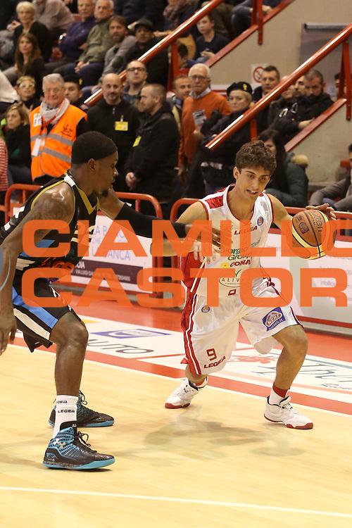 DESCRIZIONE : Campionato 2014/15 Giorgio Tesi Group Pistoia - Upea Capo d'Orlando<br /> GIOCATORE : Moretti Davide<br /> CATEGORIA : Palleggio<br /> SQUADRA : Giorgio Tesi Group Pistoia<br /> EVENTO : LegaBasket Serie A Beko 2014/2015<br /> GARA : Giorgio Tesi Group Pistoia - Upea Capo d'Orlando<br /> DATA : 25/01/2014<br /> SPORT : Pallacanestro <br /> AUTORE : Agenzia Ciamillo-Castoria / Stefano D'Errico<br /> Galleria : LegaBasket Serie A Beko 2014/2015<br /> Fotonotizia : Campionato 2014/15 Giorgio Tesi Group Pistoia - Upea Capo d'Orlando<br /> Predefinita :