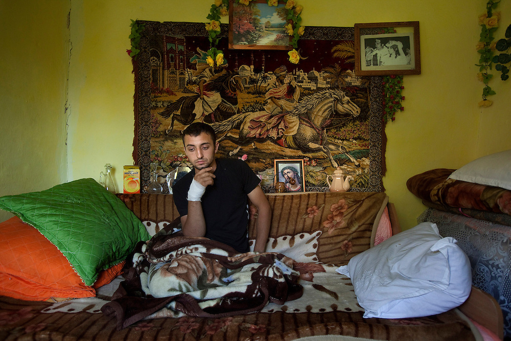 Cristi Radu sits in his bedroom after finding out that his brother, Florea, had been electrocuted in stealing copper from power lines in Spain, in Buzescu, a small town in Romania.