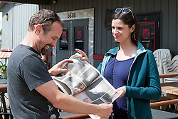 Derek Hurd and Danielle Casazza Hurd look at the Boise Weekly 14th Annual Black and White Photo Contest issue. Derek had a 2nd and honorable mention in the &quot;places&quot; category. <br /> Jodi Eichelberger's ST(r)EAM Artist Studio/Gallery bike tour in the Surel Mitchell Live-Work-Create District in Garden City, Idaho on June 18, 2016.<br /> <br /> Tour started at the studios of Susan Madacsi, April VanDeGrift, Erin Cunningham, and continued to Ken McCall Studios, James &amp; Matt Wilson of Red Valley Mandolins, Arin Arthur, Angie Bowling Sebolt, Belinda Isley, Matt Herberg, Lisa Roggenbuck and the Visual Arts Collective.