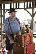 Organ grinder BILL SHARKEY plays his 20 note Jager & Brommer organ on the Boardwalk at the Fourth Annual History Day at Deno's Wonder Wheel Amusement Park and The Coney Island History Project, which had family fun music, history, and entertainment at historic Coney Island. Sharkey is a member of AMICA, Automatic Musical Instrument Collectors' Association.