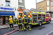 Firefighters from the London Fire Brigade respond to an emergency on Church Street, Stoke Newington, London.  They have been called out due to a large explosion in the basement of a shop.  The London Fire Brigade is the 4th largest fire-service in the world.